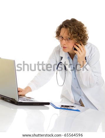 Doctor speaks by cellphone and work a laptop