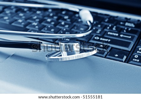 Doctor stethoscope on the laptop keyboard