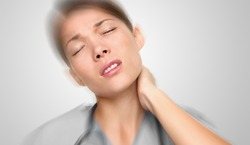Doctor stress massaging neck back pain muscle tension relief. Upset Asian woman at work tired with torticollis panoramic - Unhappy person .