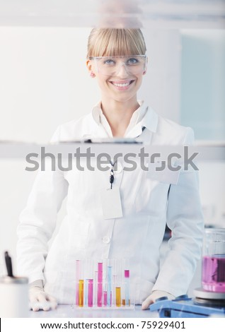 doctor student  female researcher holding up a test tube in chemistry bright labaratory