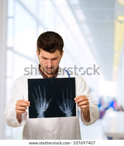 Doctor Studying Hand X-ray, Outdoor