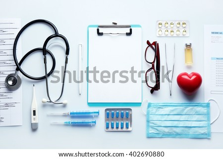 Doctor table with medicines, stethoscope and glasses, top view stock photo