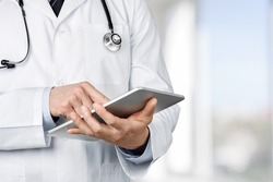 Doctor, tablet, clinic.