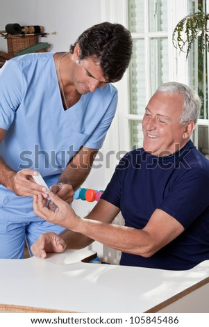 Doctor taking a blood sample from a male patient's.