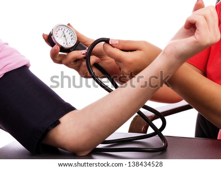 Doctor taking blood pressure against white background
