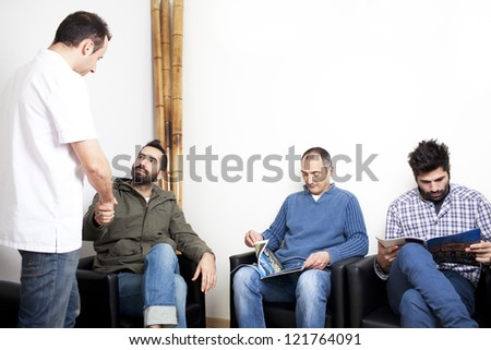Doctor talking to patient in waiting room