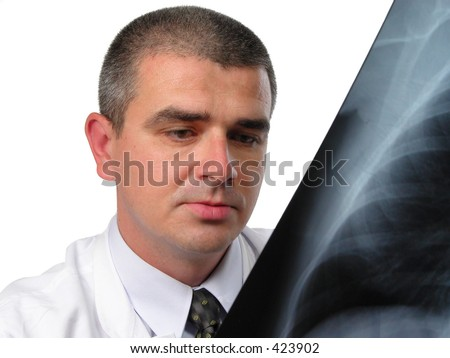 Doctor throwing a look to a chest radiography -over white background-studio shot