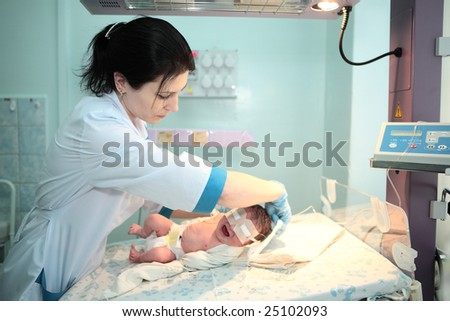 doctor  treat newborn baby in hospital