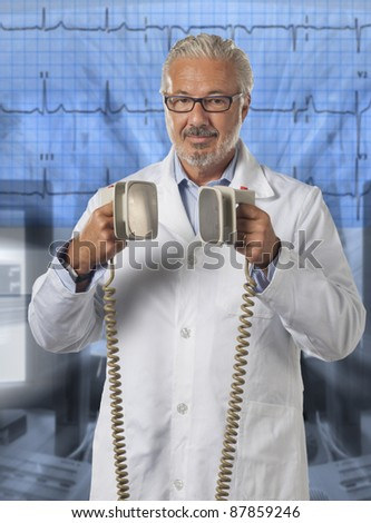 Doctor using a defibrillator at hospital