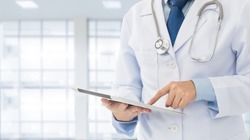 Doctor using digital tablet find information patient medical history at the hospital. Medical technology concept.