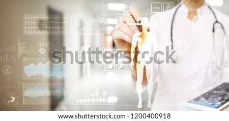 Doctor using modern computer with Medical record diagram on virtual screen concept. Health monitoring application. #1200400918