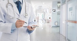 Doctor using smart phone communicate patient at the hospital. Medical technology concept.