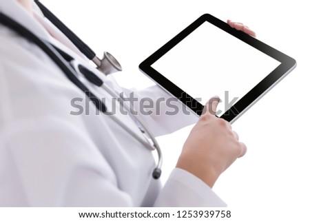 Doctor Using Tablet.Doctor showing digital tablet  #1253939758