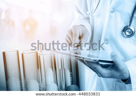 Doctor using tablet with test tubes in rack, medical research and development concept
