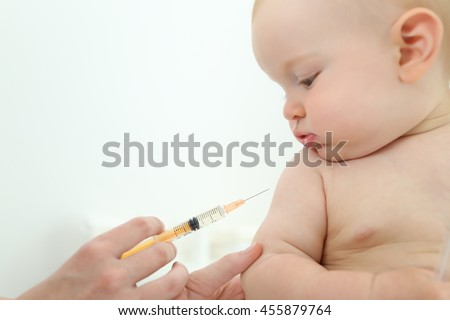 Doctor vaccinating baby