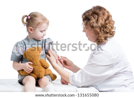 doctor vaccinating kid isolated on white