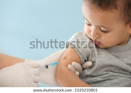 Doctor vaccinating little baby in hospital