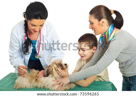 Doctor vet vaccine puppy dog and his family holding against white background