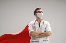 Doctor wearing facemask and superhero cape during coronavirus outbreak. Virus and illness protection, quarantine. COVID-2019. Super hero power for  medicine.