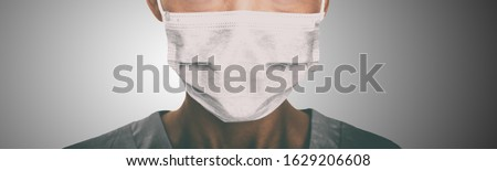 Photo of Doctor wearing protection face mask against coronavirus. Banner panorama medical staff preventive gear.