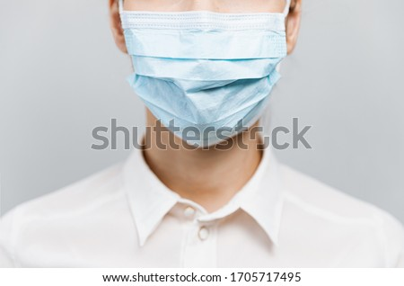Doctor wearing protection face mask against covid-19. Banner panorama medical staff preventive gear about coronavirus. Woman in medical mask stops 2019-nCov Stock fotó ©