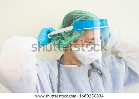 Doctor wearing protection Suit for Fighting Covid-19 (Corona virus) with white background