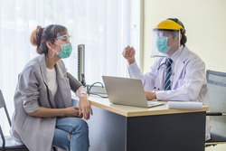 Doctor wears a mask to prevent the patient's saliva from wearing a mask, answering questions about the history of the patient infected with Corona virus covid19.Healthcare  concept.