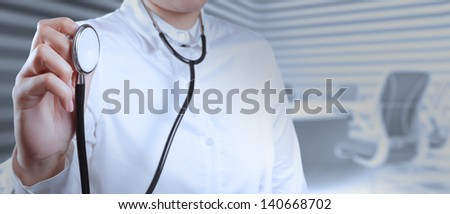 Doctor with a stethoscope in the hands on board room background