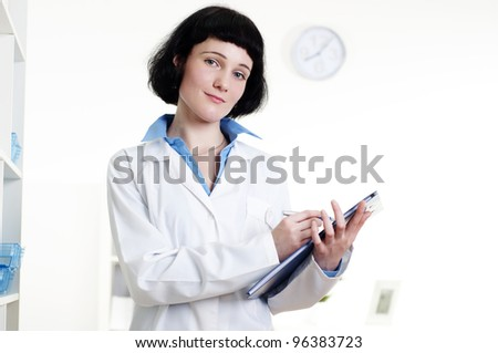 doctor with a tablet, does a note