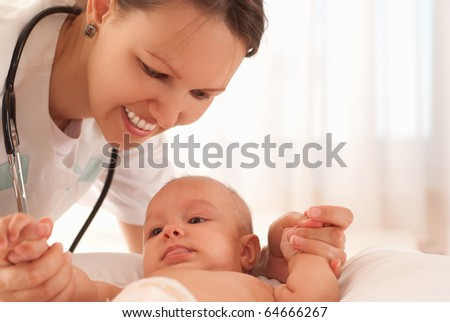 Doctor with baby on a white background