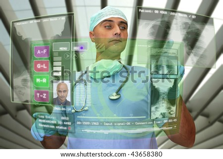 Doctor with high-tech computer screen viewing patient data