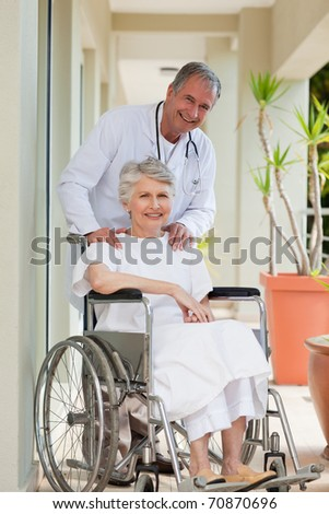 Doctor with his patient looking at the camera