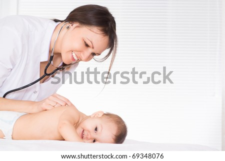 doctor with newborn on a white background