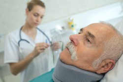 doctor with patient wearing neck brace