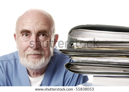 Doctor with pile of files