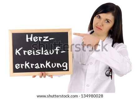 Doctor with sign and the german words cardiovascular disease / cardiovascular disease