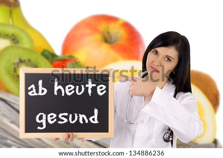 Doctor with sign and the german words from today healthy / healthy Eating