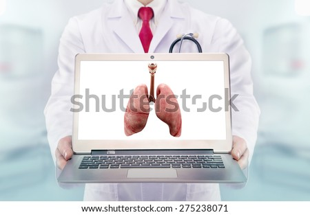 Doctor with stethoscope in a hospital. lungs on the laptop monitor. High resolution.