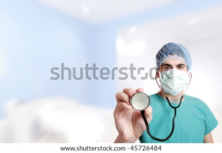 Doctor with stethoscope in emergency room lighting environment selective focus