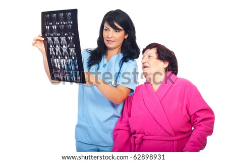 Doctor woman showing her patient the result of magnetic resonance imaging and discuss together isolated on white background