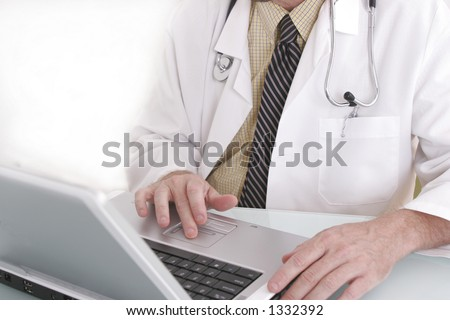 Doctor working on a notebook computer.