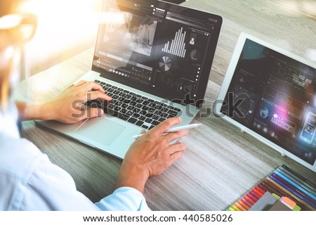 Doctor working with digital tablet and laptop computer with smart phone in medical workspace office and video conference as concept