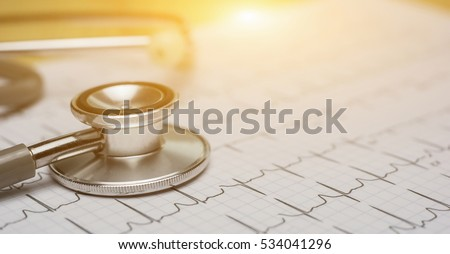 doctor workplace with a stethoscope Cardiogram chart with medical table closeup,for Surgeon heart record,selective focus,vintage color.for banner