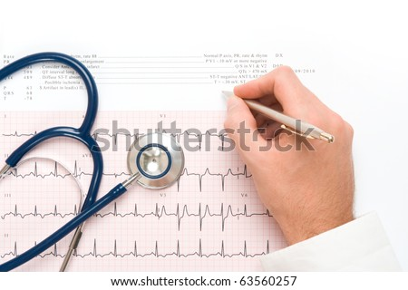 Doctor write note on electrocardiogram (ECG) output, part of stethoscope - heart checkup concept