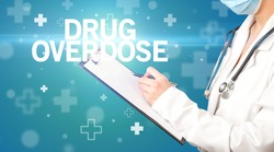 doctor writes notes on the clipboard with DRUG OVERDOSE inscription, first aid concept
