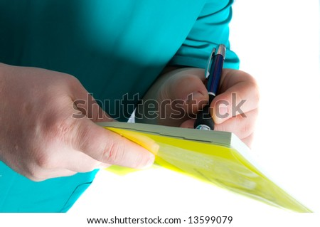 doctor writing a over white background
