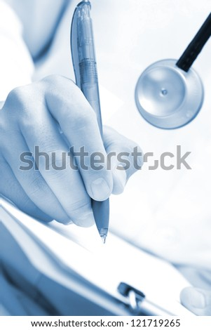 Doctor writing. Monochrome photo