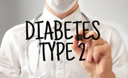 Doctor writing word DIABETES TYPE 2 with marker, Medical concept