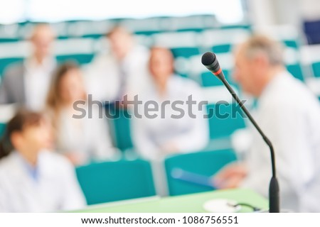 Doctors and students in medicine exam in university lecture hall