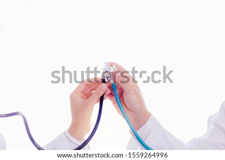 Doctors celebrating by using, touching their stethoscopes, doctor woman and doctor man gets successful for cured or heal their patient. They are good teams, collaborating, congratulating together  #1559264996